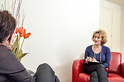 A female therapist during a one on one session with a client seeking help. Model release available