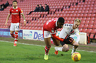 Charlton Athletic midfielder Ben Reeves (12) and Barnsley forward Mamadou Thiam (26) battle for the ball during the EFL Sky Bet League 1 match between Barnsley and Charlton Athletic at Oakwell, Barnsley, England on 29 December 2018.