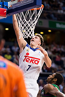 Real Madrid's player Luka Doncic and Unicaja Malaga's player Jeff Brooks during match of Liga Endesa at Barclaycard Center in Madrid. September 30, Spain. 2016. (ALTERPHOTOS/BorjaB.Hojas)