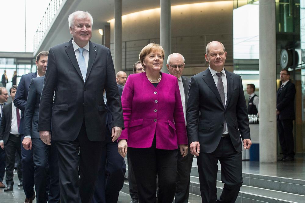 12 MAR 2018, BERLIN/GERMANY:<br /> Horst Seehofer (L), CSU, desig. Bundesinnenminister, Angela Merkel (M), CDU, Bundeskanzlerin, und Olaf Scholz (R), SPD, desig. Bundesfinanzminister, auf dem Weg zur Unterzeichnung des Koalitionsvertrages der CDU/CSU und SPD, Paul-Loebe-Haus, Deutscher Bundestag<br /> IMAGE: 20180312-02-001