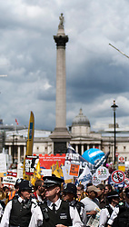 © Licensed to London News Pictures. LONDON, UK  30/06/11. Police lead protesters through central London. Around 20,000 protesters take to the streets of London to demonstrate against government public sector cutbacks. Please see special instructions for usage rates. Photo credit should read Matt Cetti-Roberts/LNP