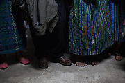 Family members of victims of forced disappearance listen to a briefing at the National Police Historical Archives headquarters. On July 5, 2005, the historical archives of the now dissolved National Police were found in an abandoned arms depot in the outskirts of Guatemala City. The discovery of these millions of documents, which were allegedly lost after the 1996 Peace Accords, provide important evidence in the search for the thousands of people who were detained and subsequently disappeared by State security forces during the internal armed conflict (1960-1996). Guatemala City, Guatemala. August 29, 2014.