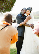 A bride and groom pose for a photographer on their wedding day in Bamako, Mali