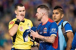 May 5, 2018 - Newcastle, NSW, U.S. - SYDNEY, NSW - MAY 05: Newcastle Jets forward Roy O'Donovan (9) cops a heavy hit on his face at the A-League Grand Final Soccer Match between Newcastle Jets and Melbourne Victory on May 5, 2018 at McDonald Jones Stadium in Newcastle, Australia. (Photo by Speed Media/Icon Sportswire) (Credit Image: © Speed Media/Icon SMI via ZUMA Press)