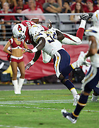 Arizona Cardinals running back David Johnson (31) gets upended by San Diego Chargers outside linebacker Melvin Ingram (54) as he runs the ball during the 2015 NFL preseason football game against the San Diego Chargers on Saturday, Aug. 22, 2015 in Glendale, Ariz. The Chargers won the game 22-19. (©Paul Anthony Spinelli)