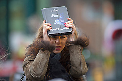 ©Licensed to London News Pictures 24/12/2019. <br /> Bromley ,UK. This shopper trying to keep dry. Last minute Christmas eve shoppers brave the wind and rain in Bromley High Street, South East London.Photo credit: Grant Falvey/LNP