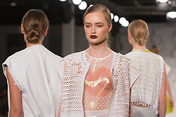 © Licensed to London News Pictures. 01/06/2014. London, England. Collection by Rosie Fawcett from the Manchester School of Art. Graduate Fashion Week 2014, Runway Show at the Old Truman Brewery in London, United Kingdom. Photo credit: Bettina Strenske/LNP