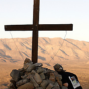 PALM DESERT, CA, OCTOBER 21, 2006: Louisa Prudhomme, mother of Anthony Prudhomme who was the murder victim in a hate crime by Latino gang members in Highland Park, CA, regularly visits the site where she buried her son's ashes. Located about 150 miles from her home, Anthony's ashes lay buried beneath a cross high atop a hill overlooking the Coachella Nature Preserve. This was a favorite spot for Anthony. (Photograph by Todd Bigelow/Aurora).