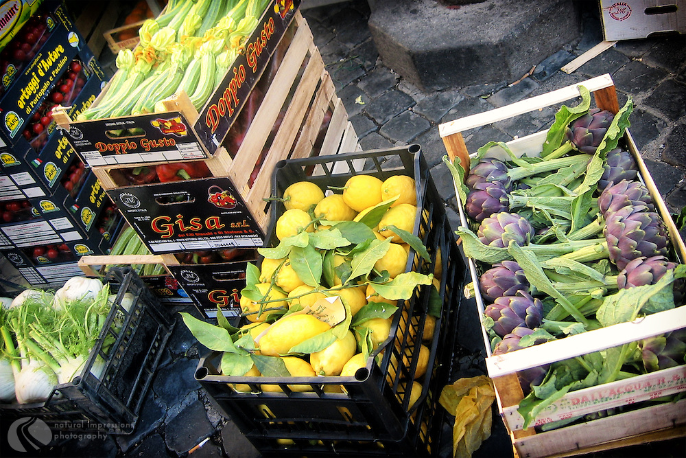 Locally grown food ready for display at a daily farmers market in Rome.