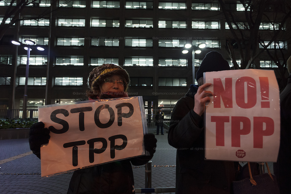 Women activists take part in a small protest against the TPP trade agreement (Trans- Pacific Partnership) outside the Ministry Of the Economy, Trade and Industry (METI) in Kasumigaseki, Tokyo, Japan. Friday February 5th 2016.  The Trans Pacific Partnership, one of the biggest multinational trade deals ever made was signed by ministers from 12 nations, including Japan, in New Zealand on Thursday February 4th. Many people in Japan are against the agreement which they fear will affect Japanese agriculture and health industries by forcing American competition onto them.