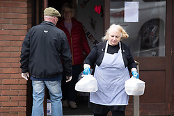 © Licensed to London News Pictures. 30/03/2020. Baddesley, North Warwickshire, UK. MP Delivery. Pictured, Angie Spencer with food parcels. North Warwickshire MP Craig Tracey turns delivery man to help deliver meals in his constituency. When Atherstone coffee shop owner Angie Spencer decided to make meals for people who were housebound she asked for volunteers to help deliver the meals. The local community responded along with local MP Craig Tracey. The meals will be delivered on Mondays and Fridays to start with, the first going out today (Monday 30th March) with over 100 meals being delivered. Angie has put out a request for more drivers should the need rise. Angie, a local town councillor started the idea along with business partner Stephen Reay and asked Warwickshire County Council to help with the scheme. Photo credit: Dave Warren / LNP
