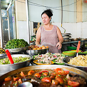 Woman at street food stall in Saigon