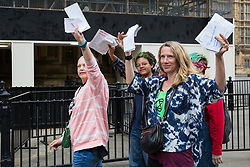 London, UK. 23rd April 2019. Four of ten climate change activists from Extinction Rebellion permitted to deliver letters to Members of Parliament requesting meetings to discuss the issue of climate change.