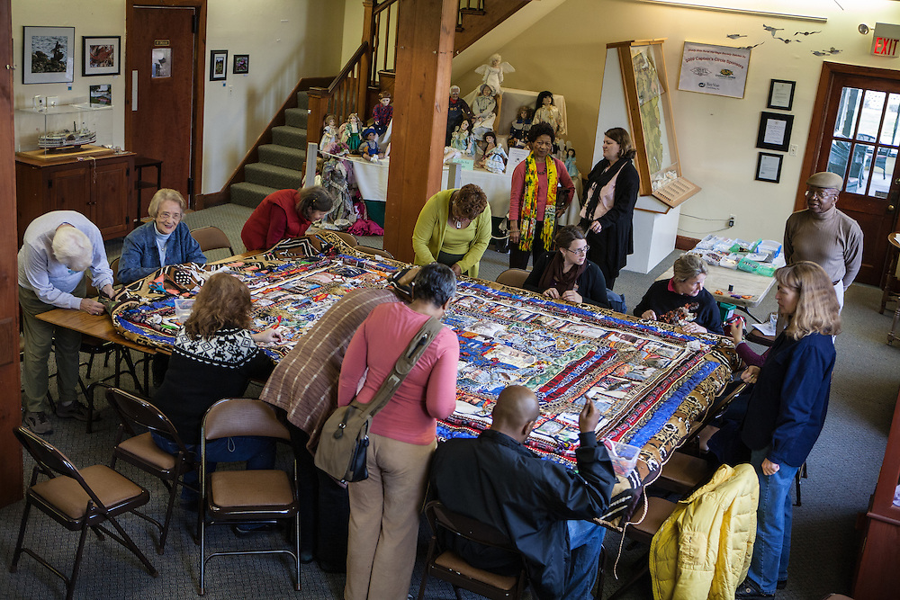 Shady Side, Maryland, US - 21 September 2009. Volunteers assemble a quilt pieced from memorabilia of black watermen at the Salem Avery Museum in Shady Side, Maryland.