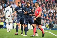 "Malaga CF's Weligton Robson and Jose Luis ""Recio"" Garcia talking with the referee during La Liga match between Real Madrid and Malaga CF at Santiago Bernabeu Stadium in Madrid, Spain. January 21, 2017. (ALTERPHOTOS/BorjaB.Hojas)"