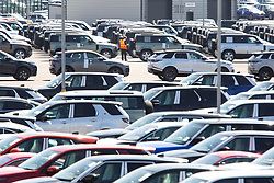 © Licensed to London News Pictures. 22/04/2020. Near Coventry, North Warwickshire, UK. JLR Stocks. A lone worker keeps a check on vehicles at the Jaguar Landrover distribution site in North Warwickshire. Photo credit: Dave Warren / LNP
