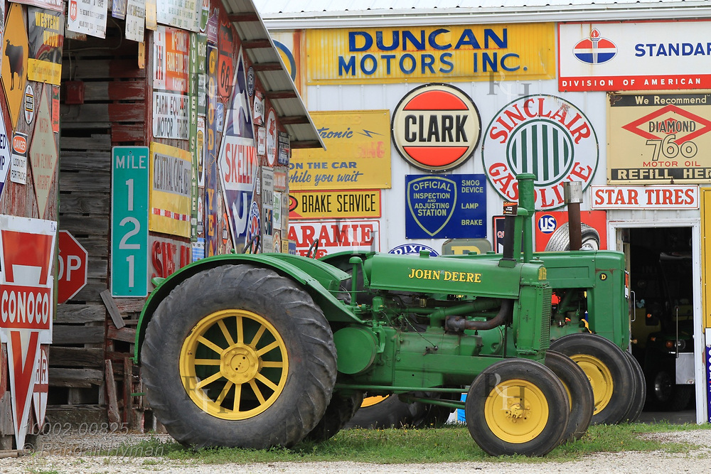 Sign collection and old John Deere tractors fill Hal Colliver's farm in Keota, Iowa.