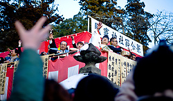 Visitors to the Shiogama shrine, the most important shrine in Japan's Tohoko region which was devastated by a tsunami last March, hold their arms out to catch beans signifying good luck thrown by priests and local dignitaries  on the eve of Spring. The tradition, known as Setsubun (seasonal division) , or bean throwing ceremony, starts with a ritual to cleanse away all the evil of the previous year. The first day of Spring is traditionally February 4 in Japan despite much of the country being covered in snow. Friday February 1, 2012. Photo By Andrew Parsons/ i-Image..