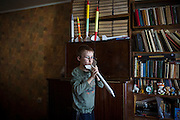 Yaroslav, 10, is playing with some of the parachuted paper rockets he has built, while in the provisional home where he resides with his mother Olga, 36, as internally displaced persons. (IDPs) Yeroslav is taking part to the UNICEF-sponsored One Minute Junior project for internally displaced persons (IDPs), carried out by the local NGO 'Ukrainian Frontiers' in the city of Kharkiv, the country's second-largest, in the east. The conflict between Ukrainian army and Russia-backed separatists nearby, in the Donbass region, have left more than 10000 dead since April 2014, including over 1000 since the shaky Minsk II ceasefire came into effect in February 2015. The approximate number of people displaced by the conflict is 1.4 million as of August 2015. Yeroslav's mother, Olga, is also a participant to a different project of 'Ukrainian Frontiers', called 'Self-Employment', first as a beneficiary, and now as a paid hotline coordinator for people seeking jobs and formation courses.