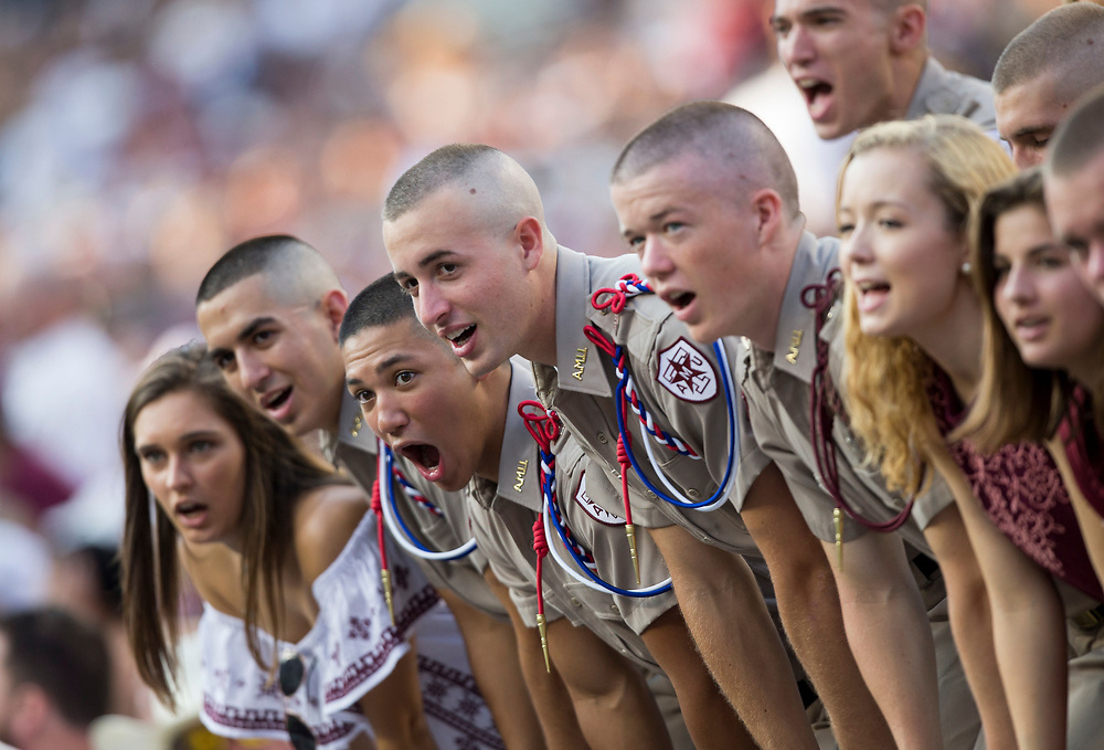 Members of then Texas A&M Corps of Cadets yell out cadence's during an NCAA college football game against Nicholls State Saturday, Sept. 9, 2017, in College Station, Texas. (AP Photo/Sam Craft)