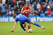 Lee Peltier (14) of Middlesbrough battles for possession with Rubin Colwill (27) of Cardiff City during the EFL Sky Bet Championship match between Cardiff City and Middlesbrough at the Cardiff City Stadium, Cardiff, Wales on 23 October 2021.