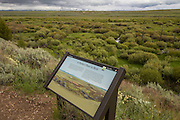A sign marks the view, of the location below, where a battle betwen the Nez Perce and U.S. Cavalry was fought in 1877. Big Hole National Battlefield, Montana.