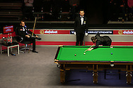 Mark Selby (Eng) in action with Barry Hawkins (Eng) watching on. Barry Hawkins (Eng) v Mark Selby (Eng) , Quarter-Final match at the Dafabet Masters Snooker 2017, at Alexandra Palace in London on Friday 20th January 2017.<br /> pic by John Patrick Fletcher, Andrew Orchard sports photography.