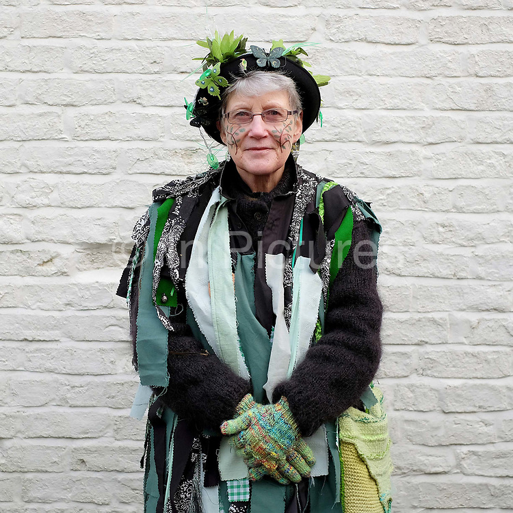 A member of the Makara Morris Men at an orchard-visiting wassail in Kilham village, Yorkshire Wolds, UK on 21st January 2017. Wassail is a traditional Pagan winter celebration in cider-producing regions of England, reciting incantations and singing to the trees to promote a good harvest for the coming year. Pieces of toast soaked in cider are hung in the branches to attract robins to the tree as these are said to be the good spirits of the orchard. To ward off evil spirits, villagers scare them away by banging pots and pans and making as much noise as possible