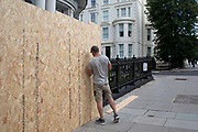 A workman puts up fencing as homes and businesses are fenced off and boarded up in preparation for the upcoming Notting Hill Carnival on August 22nd 2019 in London, England, United Kingdom. An expected 1 million revellers are expected to visit Carnival on the weekend, so many owners have decided to protect their properties as a precaution.