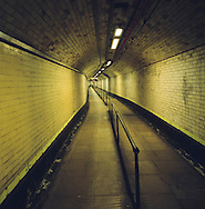 A deserted passenger foot tunnel at James Street railway station in Liverpool on the river Mersey. The  Mersey is a river in north west England which stretches for 70 miles (112 km) from Stockport, Greater Manchester, ending at Liverpool Bay, Merseyside. For centuries, it formed part of the ancient county divide between Lancashire and Cheshire.