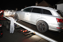 © Licensed to London News Pictures. 17/03/2019. London, UK. Police remove a damaged Audi car from Viola Avenue in Stanwell after police said that they are treating a stabbing incident last night as a terrorism. Counter Terrorism Policing South East are leading an investigation into an incident last night, which has now been declared a terrorist incident, following the arrest of a man on suspicion of attempted murder and racially aggravated public order in Stanwell. Photo credit: Peter Macdiarmid/LNP