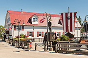 The Sons of Norway Hall Fedrelandet Lodge and Viking ship in Bojer Wikan Fishermens Memorial Park in Petersburg, Mitkof Island, Alaska. Petersburg settled by Norwegian immigrant Peter Buschmann is known as Little Norway due to the high percentage of people of Scandinavian origin.