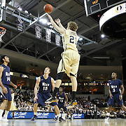 Central Florida forward P.J. Gaynor (21) shoots the ball over Arsalan Kazemi (14) of Iran, and Trey Stanton (15),  during a Conference USA NCAA basketball game between the Rice Owls and the Central Florida Knights at the UCF Arena on January 22, 2011 in Orlando, Florida. Rice won the game 57-50 and extended the Knights losing streak to 4 games.  (AP Photo/Alex Menendez)