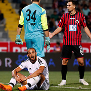 Genclerbirligi's goalkeeper Per Johannes Hopf (C) and Besiktas's Cenk Tosun (L) during their Turkish Super League soccer match Genclerbirligi between Besiktas at the 19 Mayis stadium in Ankara Turkey on Monday, 21 September 2015. Photo by Kurtulus YILMAZ/TURKPIX