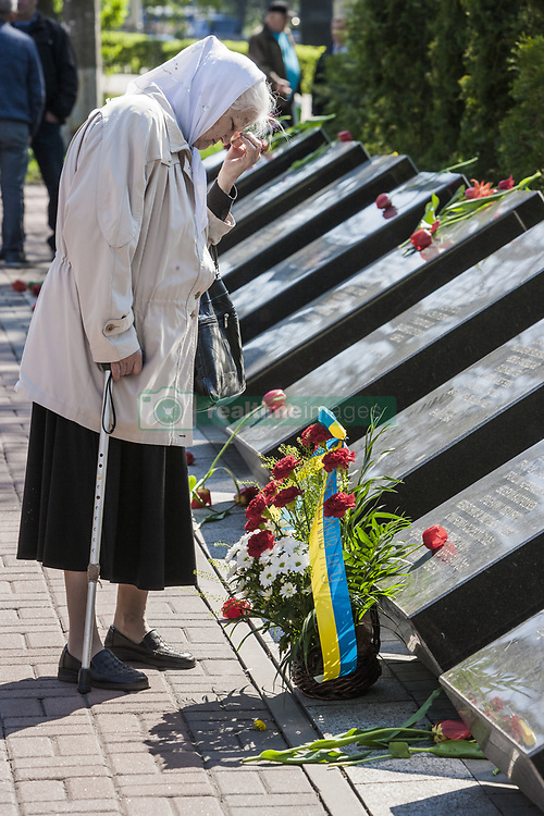 April 26, 2018 - Kiev, Kiev, Ukraine - Old woman prays in the memorial of the dead Chernobyl workers during the celebrations in Kiev of the 32nd anniversary of the Chernobyl  nuclear accident, Ukraine. (Credit Image: © Celestino Arce via ZUMA Wire)