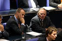 21 OCT 2004, BERLIN/GERMANY:<br /> Friedrich Merz (L), MdB, CDU, Stellv. Fraktionsvorsitzender der CDU/CSU Bundestagsfraktion, und Wolfgang Schaeuble (R), MdB, CDU, ehem. Fraktions- und Parteivorsitzender, in den Reihen der CDU/CSU Fraktion, Bundestagsdebatte, Plenum, Deutscher Bundestag<br /> IMAGE: 20041021-01-050<br /> KEYWORDS: Wolfgang Schäuble