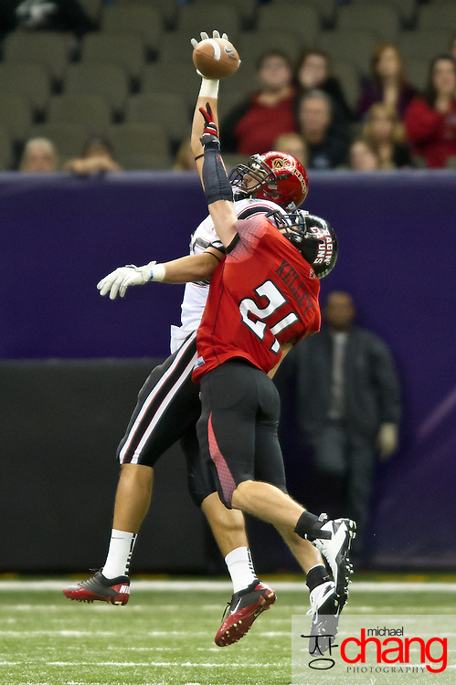 Louisiana-Lafayette's Lance Kelley LB (21) attempts to break up a pass during the R+L Carriers New Orleans Bowl at the Mercedes-Benz Superdome.  Louisiana-Lafayette defeated San-Diego State 32-30. (Copyright Michael Chang)