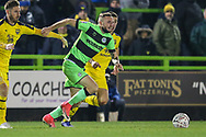 Forest Green Rovers Carl Winchester(7) runs forward during the The FA Cup 1st round replay match between Forest Green Rovers and Oxford United at the New Lawn, Forest Green, United Kingdom on 20 November 2018.