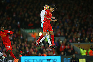 Havard Nordtveit of West Ham United and Roberto Firmino of Liverpool jump for the ball. Premier League match, Liverpool v West Ham Utd at the Anfield stadium in Liverpool, Merseyside on Sunday 11th December 2016.<br /> pic by Chris Stading, Andrew Orchard sports photography.