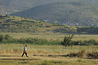 Out to work in the field. Lake Prespa National Park, Albania June 2009