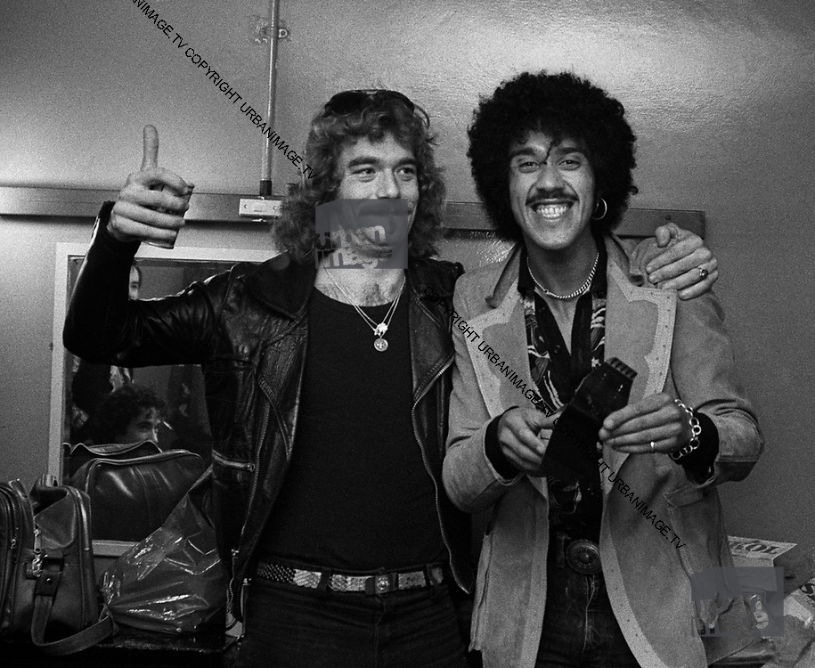 Thin Lizzy Phil Lynott with Huey Lewis backstage London 1978