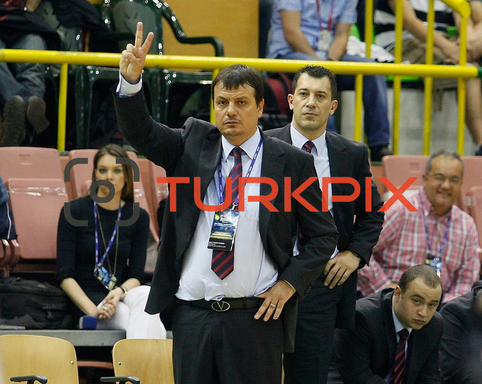 Efes Pilsen's coach Ergin ATAMAN (F) and co trainer Ufuk SARICA (B) during their Turkish Basketball league Play Off Final second leg match Efes Pilsen between Fenerbahce Ulker at the Ayhan Sahenk Arena in Istanbul Turkey on Saturday 22 May 2010. Photo by Aykut AKICI/TURKPIX
