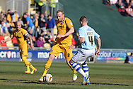 Lee Minshull of Newport county © goes past Exeter's Scot Bennett. Skybet football league two match, Newport county v Exeter city at Rodney Parade in Newport, South Wales on Sunday 16th March 2014.<br /> pic by Andrew Orchard, Andrew Orchard sports photography.