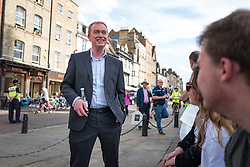 © Licensed to London News Pictures. 31/05/2017. Cambridge, UK. Leader of the Liberal Democrats TIM FARRON (L) speaks with members of the public outside Senate House in Cambridge. Farron will appear in the BBC General Election Debate this evening. Photo credit: Rob Pinney/LNP