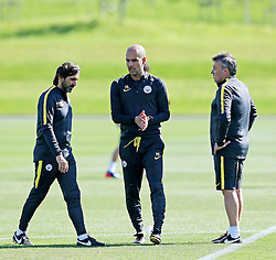 Manchester City manager Josep Guardiola talks with his coaching staff - Mandatory by-line: Matt McNulty/JMP - 23/08/2016 - FOOTBALL - Manchester City - Training session ahead of Champions League qualifier against Steaua Bucharest