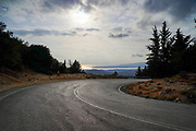 curving winding road through the pine forest of Zakynthos Island, Greece