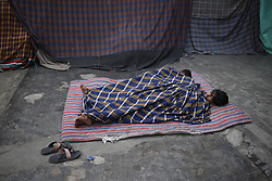 November 2, 2018 - Dhaka, Bangladesh - Coating shop workers sleeping in front of shop on an early morning near Azim Pur. (Credit Image: © MD Mehedi Hasan/ZUMA Wire)