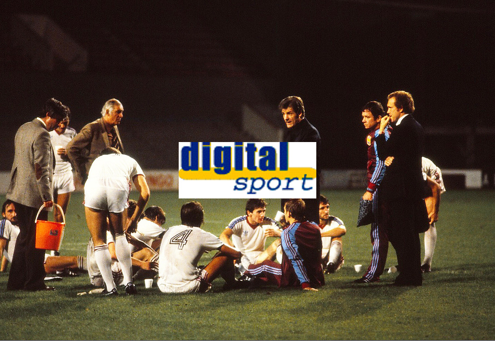 """Football - 1980 / 1981 Cup Winners Cup - Round One, Second Leg - West Ham United vs Castilla - Upton Park.<br /> West ham Manager, John Lyall talks to his players on the pitch.<br /> <br /> In these current Covid times of sporting restrictions, it's 40 years ago on the 1st October that the """"Ghost"""" Game was played behind closed doors at Upton Park.<br /> Because of crowd trouble in the first leg in Madrid, WHU were fined £7,650 and ordered to play their next two European home games at least 187 miles (300 kilometres) from Upton Park. The second leg was initially moved for Roker Park, Sunderland, but, after an appeal, the penalty was reduced to one home game behind closed doors.<br /> The attendance that night was 262, consisting of invited representatives of the teams, officials and media.<br /> WHU won 3-1 on the night to take the tie into extra time and two more goals from David Cross, who finished with a hat-trick, saw the Hammers through to the second round on aggregate, 6-4."""