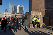 Three days after the killing of Jack Merritt, 25, and Saskia Jones, 23, by the convicted teorrorist Usman Khan at Fishmongers' Hall on London Bridge, police officers make a high-profile presence to ensure the public feel safe, on 2nd December 2019, in London, England.