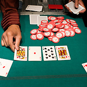 a dealer shows a near perfect set of cards at The Mirage poker room, Las Vegas.